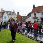 Photograph of tables being set up outside the Tiger, North Newbald, for the 2012 Jubilee celebrations