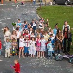 Children waving on The Green as part of the Jubilee celebrations in Newbald 2012